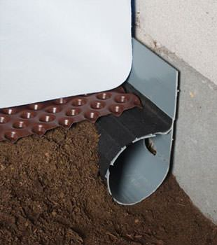 Closeup of a crawl space drainage system installed in Reidsville