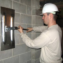 installing a wall anchor to repair an bowing foundation wall in Hilton Head Island
