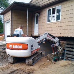 Excavating to expose the foundation walls and footings for a replacement job in Hinesville