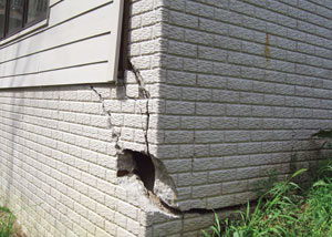 A severely damaged foundation wall in Goose Creek