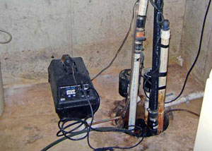 Pedestal sump pump system installed in a home in Griffin