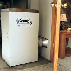 A basement dehumidifier with an ENERGY STAR® rating ducting dry air into a finished area of the basement  in Bonaire