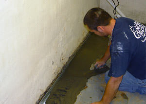 Restoring a concrete slab floor with fresh concrete after jackhammering it and installing a drain system in Brunswick.