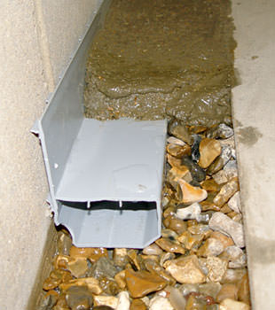 A basement drain system installed in a Summerville home